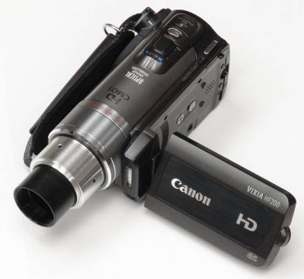 Canon HF200 video camera with 30mm eyetube adapter attached