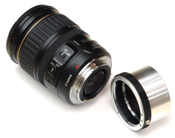 EF mount to M42x1 adapter next to Canon EF 28-135mm F/3.5-5.6 IS USM lens